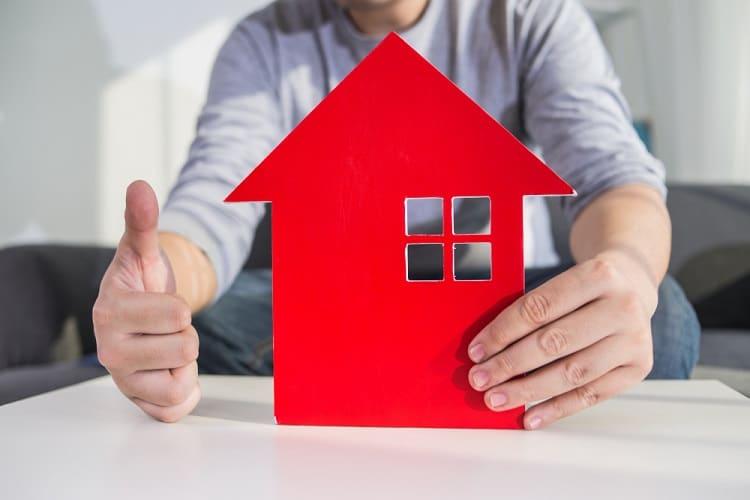 businessmen-hold-house-model-in-hand-min