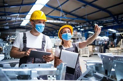 factory-workers-with-face-masks-protected-against-corona-virus-doing-quality-control-of-production-in-factory-min