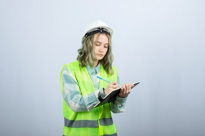 photo-of-young-female-engineer-writing-her-ideas-on-notebook-over-white-wall-high-quality-photo-min
