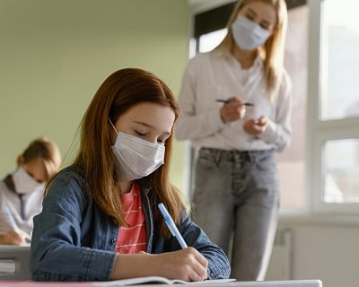 children-with-medical-masks-learning-school-with---female-teacher