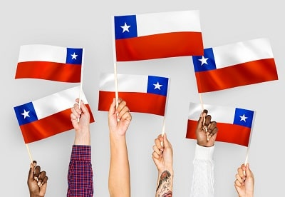 hands-waving-flags-of-chile-min