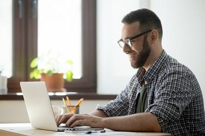 male-writing-computer