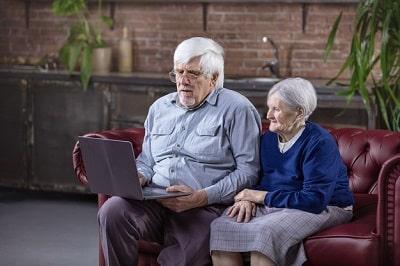 mature-man-senior-woman-using-laptop