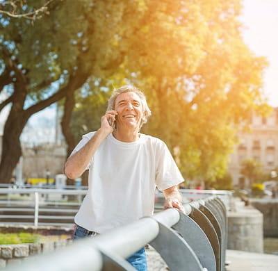 smiling-senior-man-talking-mobile-phone