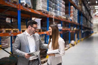 warehouse-managers-visiting-large-warehouse-checking-distribution-min