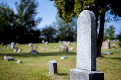 closeup-shot-of-gravestone-with-blurred-background-at-daytime-min