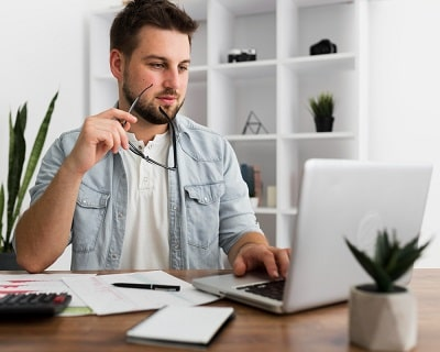 portrait-of-casual-male-working-from-home-min